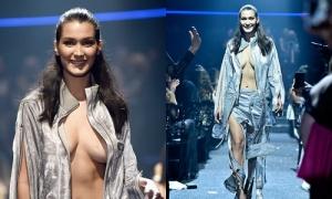 Người mẫu 19 tuổi bị bung băng dính ngực khi catwalk