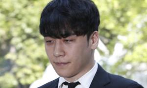Seungri bị trói tới sở cảnh sát